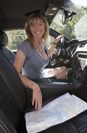 Female driver using map to plan route photo