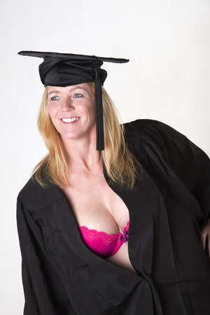 sexy middle aged woman: Female mature university student wearing cap and gown