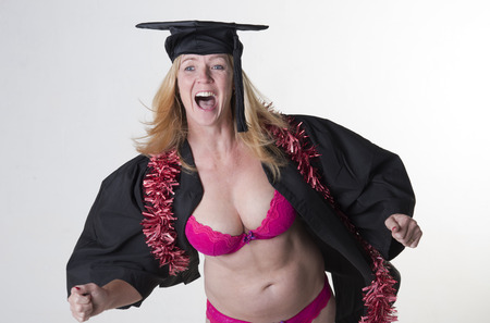 cleavage: Mature student celebrating at graduation party