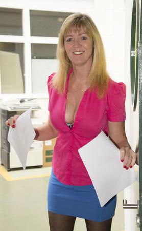 Secretary wearing short skirt and low cut shirt