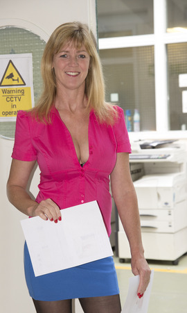 secretarial: Secretary wearing short skirt and low cut shirt
