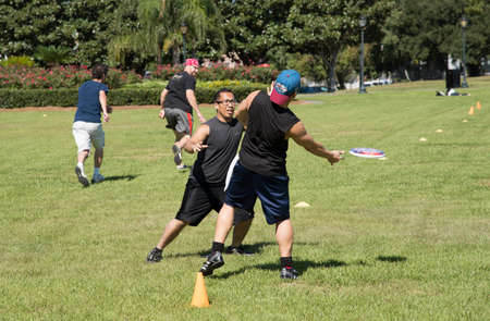 flying disc: People playing Game with flying disc in a New Orleans park USA
