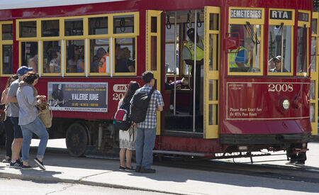 streetcar: Passengers boarding a streetcar on Canal Street New Orleans USA