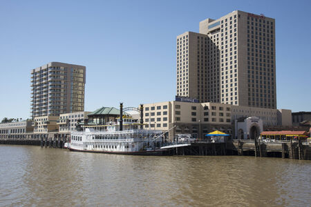 alongside: The Creole Queen riverboat alongside Riverboat Docks New Orleans USA Editorial