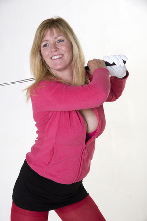 Attractive mid age female golfer photo