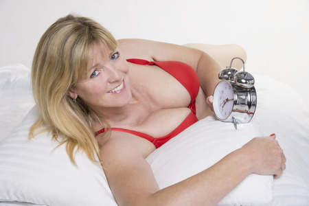 Woman checking her alarm clock photo