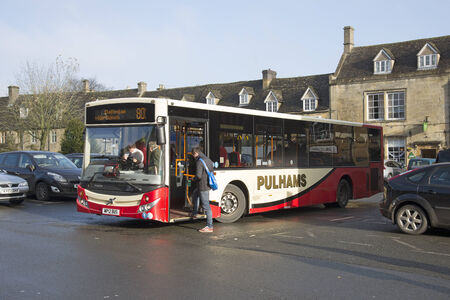 wold: Public bus service in the Cotswolds Bus departing Stow on the Wold town centre Gloucestershire UK