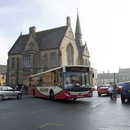 Public bus service in the Cotswolds Bus departing Stow on the Wold town centre Gloucestershire UK