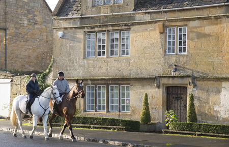 gloucestershire: Horse riders in Broadway a Cotswolds town in Gloucestershire England UK