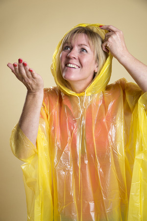Woman in Poncho in wet weather