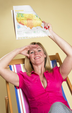 weather report: Holidaymaker reading the weather report