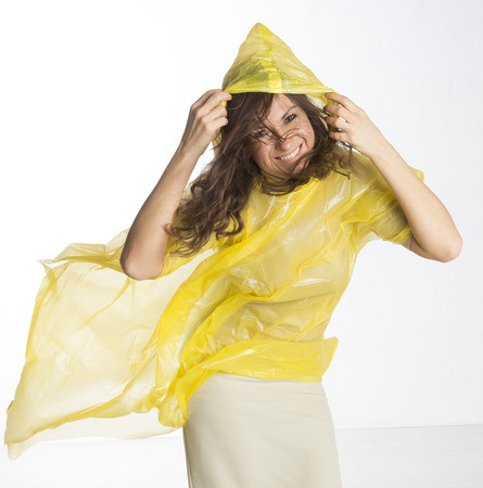 windy: Woman wearing a poncho in damp windy conditions