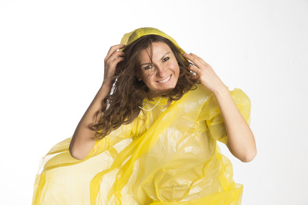 damp: Woman wearing a poncho in damp windy conditions