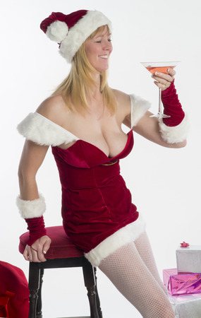 Woman in Santa costume with fizzy drink