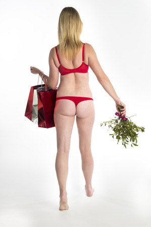 Woman in red underwear with Christmas shopping photo