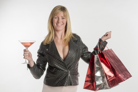 bubbly: Woman with glass of bubbly holding shopping bags