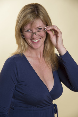 rimless: Woman in low cut dress with rimless glasses