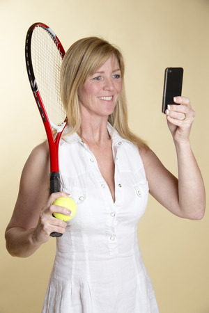 smile please: Female tennis player taking a selfie Stock Photo