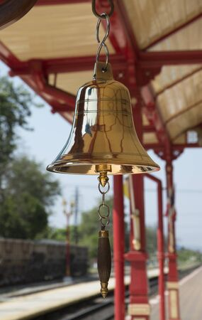railroad station: Brass bell highly polished on a Thai railroad station
