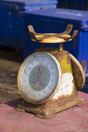 rusting: Rusting metal scales in use at a fish market Thailand