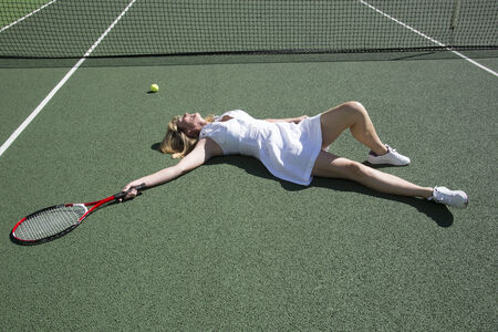 Tennis player on the ground after missing a shot photo
