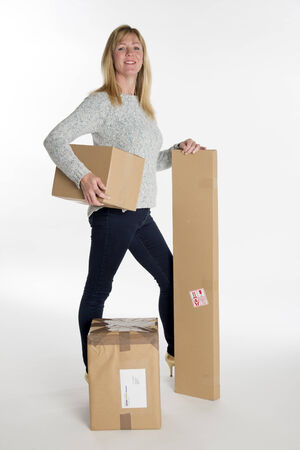 carrying: Woman carrying cardboard boxes