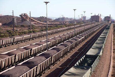 redish: Iron Ore on railway wagons Salanaha Bay Terminal South Africa