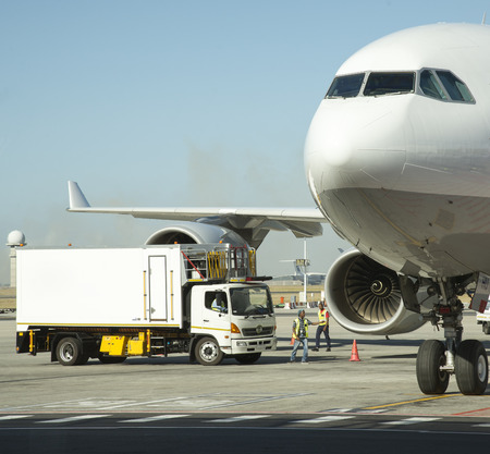 replenishing: Catering truck under wing of an aircraft