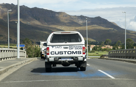 South African Revenue Service customs vehicle and beware of dogs sign Editorial