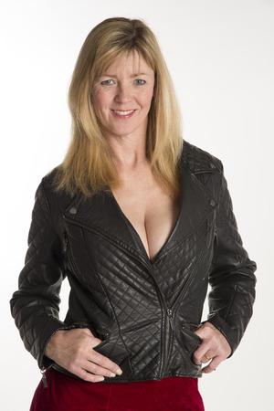 Portrait of a smiling woman wearing low cut jacket