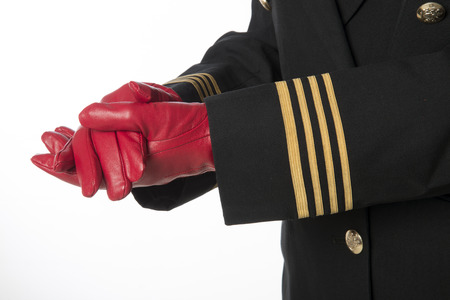 arm bands: Four gold rings on airline officers uniform Clenched hands in gloves