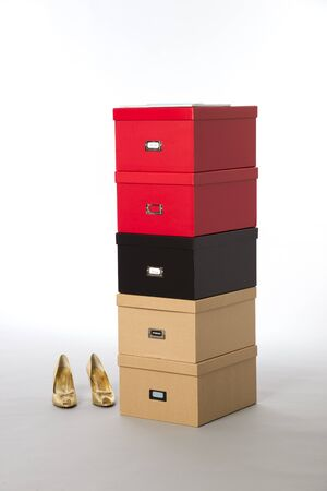 Shoe storage boxes in different colours photo
