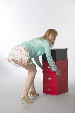 tantalizing: Office worker bending and moving boxes