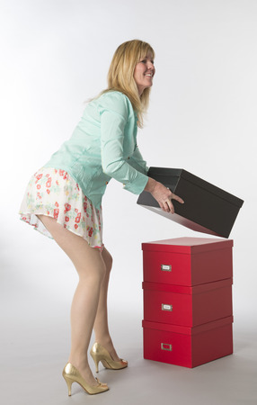 tantalising: Office worker bending and moving boxes