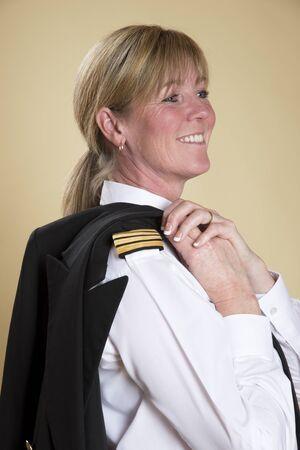personal grooming: Attractive female airline pilot smiling portrait