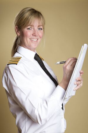 personal grooming: Female airline pilot holding a pen