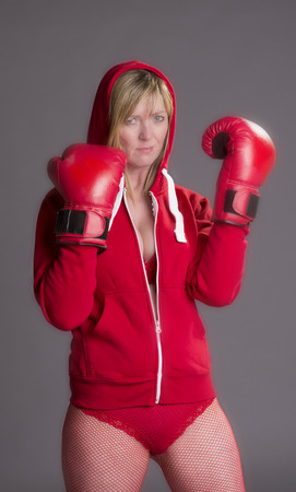 fishnet tights: Woman fighting fit and wearing red boxing gloves