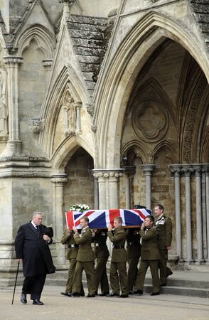 bowman: Military funeral coffin of Major Josh Bowman !st Battalion The Royal Gurkha Rifles  killed in Afganistan being carried by comrades from Salisbury Cathedral Wiltshire England Editorial