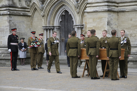 bowman: Military funeral. Coffin of Major Josh Bowman killed in Afganistan The Union flag his cap & medals having been removed from the coffin by comrades at Salisbury Cathedral Wiltshire England