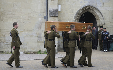 Military funeral. Coffin of Major Josh Bowman killed in Afganistan The Union flag his cap & medals having been removed from the coffin by comrades at Salisbury Cathedral Wiltshire England