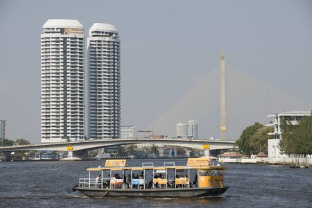 the chao phraya river: Water taxi crossing the Chao Phraya River in Bangkok Thailand