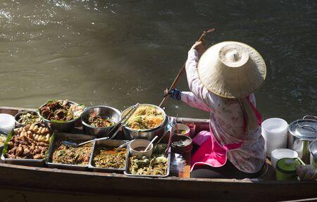 afloat: The Damnoen Saduak Floating Market about 60 miles from Bangkok Thailand Stock Photo
