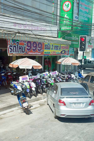 sidewalk sale: Shop selling scooters with a display on the sidewalk Bangkok Thailand