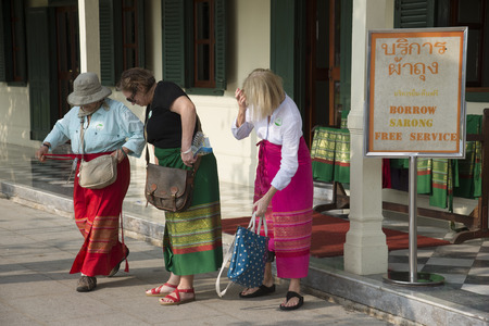 borrowed: Tourists borrow a sarong before entering a religious temple Thailand