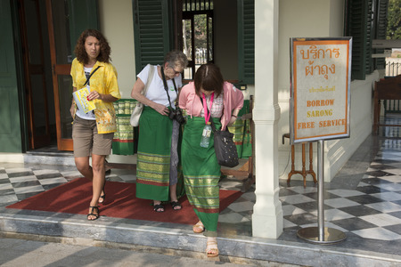 borrow: Tourists borrow a sarong before entering a religious temple Thailand