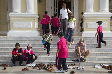 bang pa in: Students visiting Bang Pa In Palace Thailand leave their shoes before entering the building