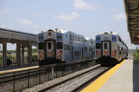 tri: Tri Rail trains departing and arriving at Boca Raton Station Florida USA Editorial