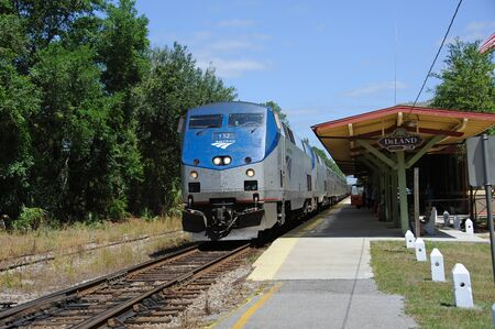 loco: AMTRAK Silver Meteor passenger train arriving at Deland Railroad Station Florida USA bound for Miami on the Atlantic Coast Service from New York