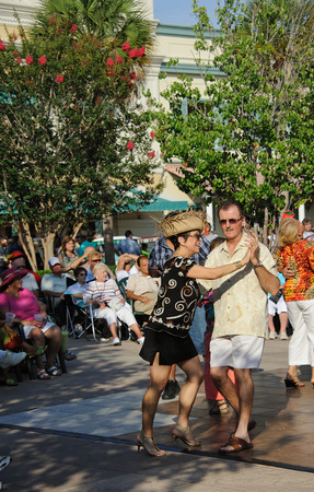 fiestas: Residents of The Villages in Florida USA dancing in the town square during the Cinco De Mayo festival
