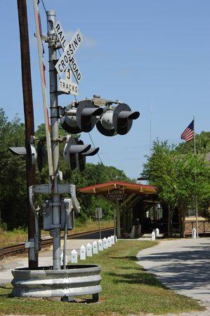 warning lights: 3 Track railroad crossing at Deland AMTRAK Station Florida USA warning lights Editorial